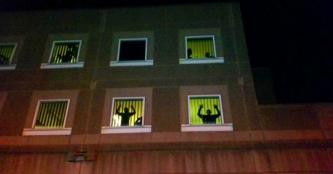 Inmates at the windows of Boston jail as protests against police violence streamed past.